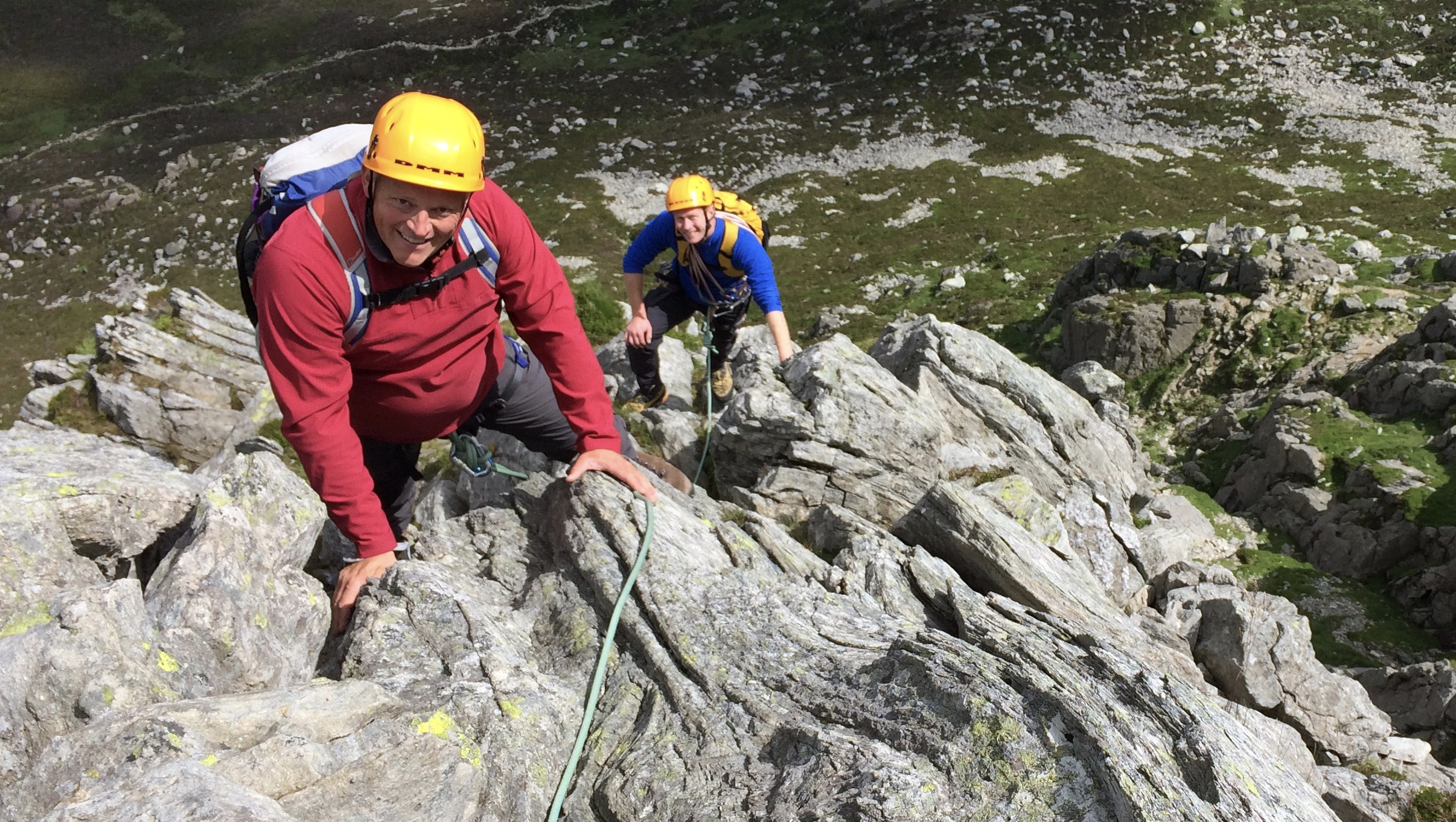 2 climbers scrambling up a rocky ridge in North Wales