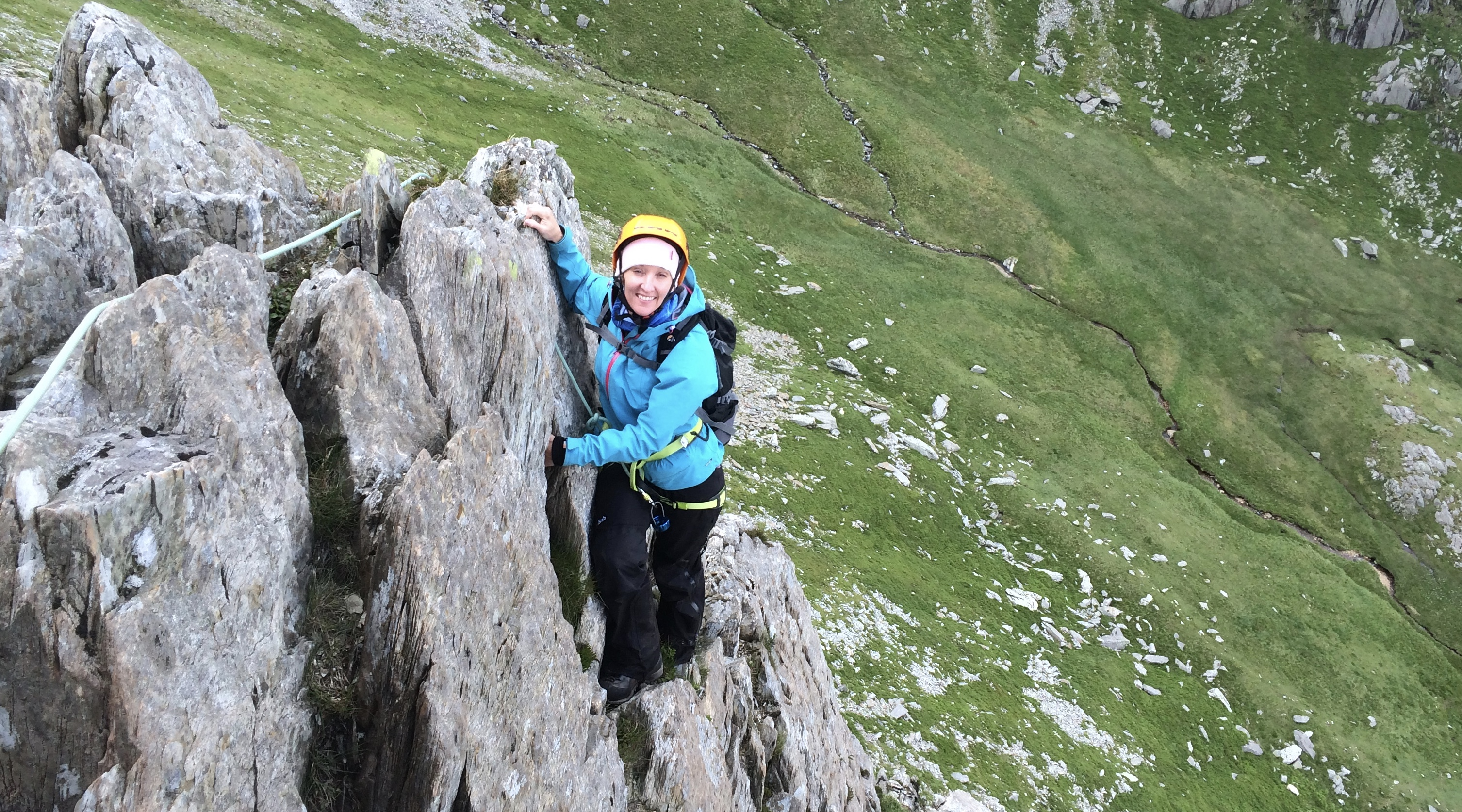 Female scrambler on a rocky ridge in North Wales